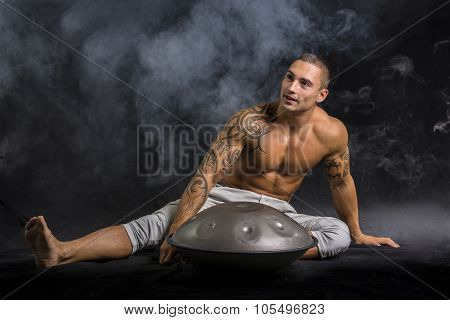 Male Drummer Drumming on Steel Drums in Studio
