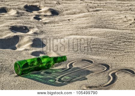 Empty Green Bottle Lying On The Sand