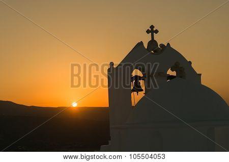 Silhouette of church Saint Antony in Paros island against the sunset.