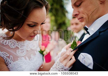 Bride Groom Wears A Buttonhole