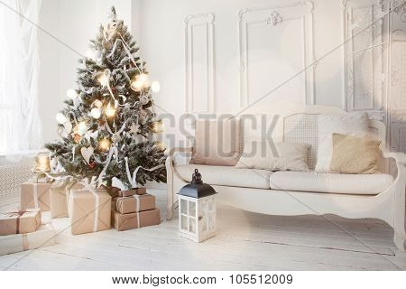 Christmas tree with presents underneath in living room