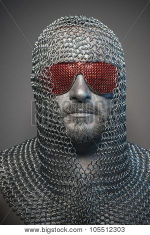 man in chain mail and leather painted silver, medieval warrior