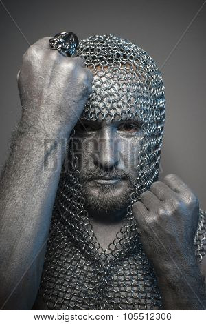 Fantasy, man in chain mail and leather painted silver, medieval warrior