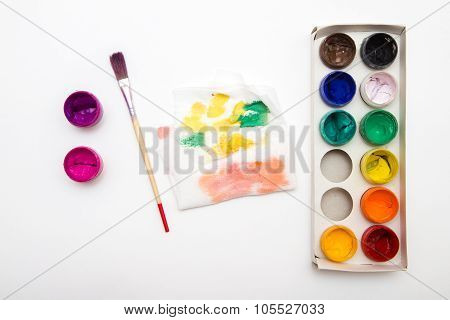 open paintbox gouache colors with brush and palette on white poster