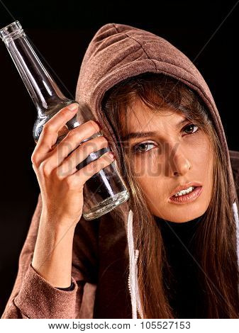 Drunk girl holding bottle of alcohol. Soccial issue alcoholism. poster