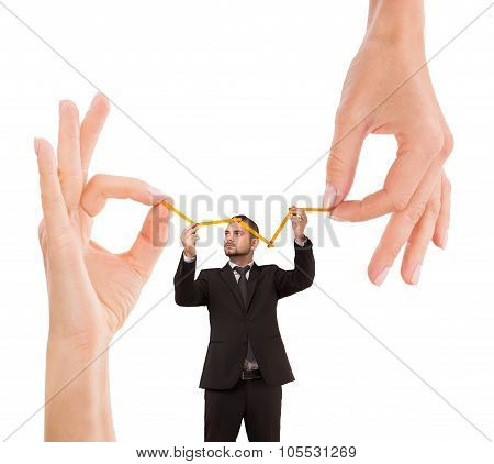 Businessman and woman's hand holding metre