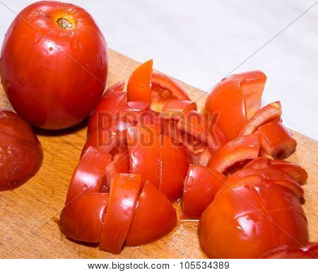 Tomato on the wooden board