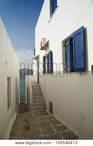 Little alley on Paros island with view on the mediteranean see