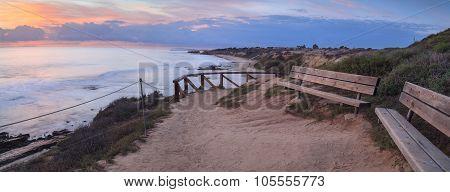 Bench at sunset at Crystal Cove Beach