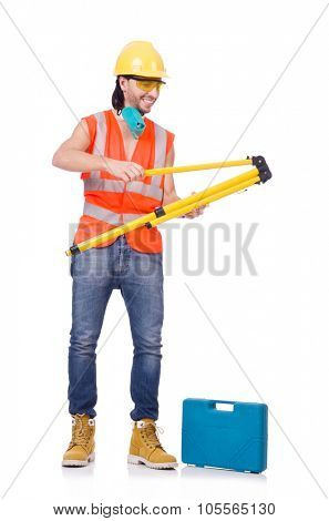 Young surveyor with tripod isolated on white