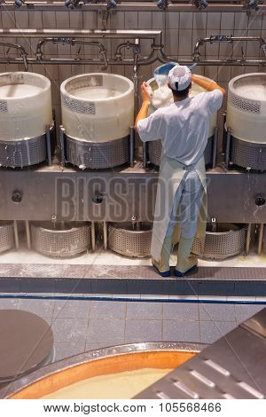 Cheesemaker At The Gruyere Cheese Factory