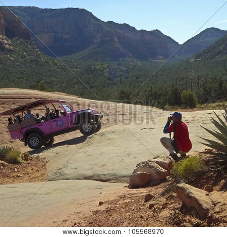 A Photographer Shoots A Tour Jeep In Sedona