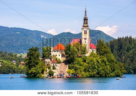 Famous Catholic Church On Island In The Middle Of Bled Lake With Tourists And Boats