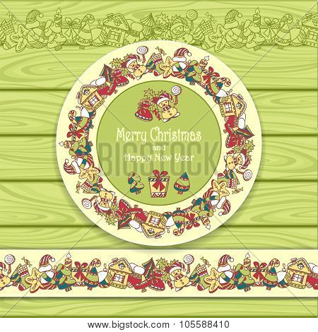 Circle frame and border from Christmas  elements on Light green wood background