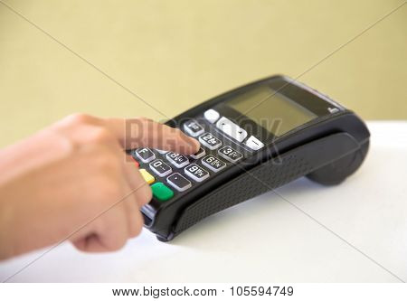 A portrait of EDC ( electronic Data Capture) machine hand pressing password on it poster