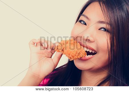 Young Woman Biting Fried Chicken, Vintage Tone