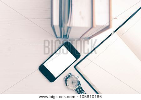 Cellphone With Stack Of Book And Watch Vintage Style