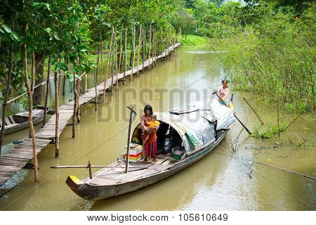 A woman pick flower on a boat in Angiang, Vietnam.
