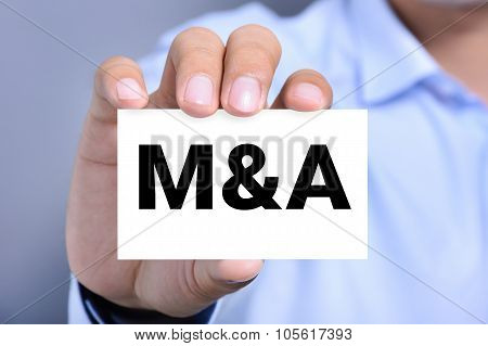M & A Letters (or Merger And Acquisition) On The Card Shown By A Man
