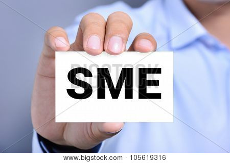 Sme Letters (or Small And Medium-sized  Enterprises) On The Card Shown By A Man
