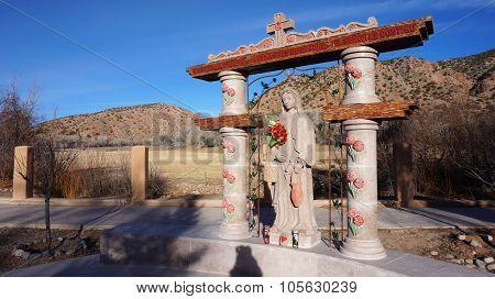 Statue At El Santuario De Chimayo In Chimayo, New Mexico.