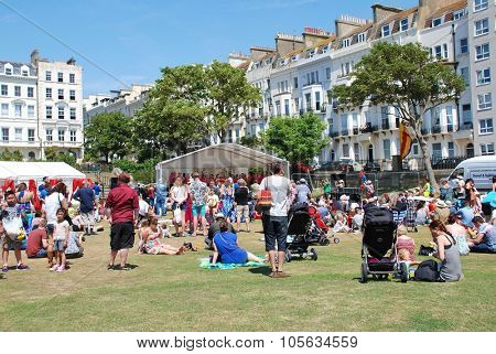 ST. LEONARDS-ON-SEA, ENGLAND - JULY 11, 2015: People enjoy the annual St.Leonards Festival held in Warrior Square Gardens. The free community music and entertainment event was first held in 2006.