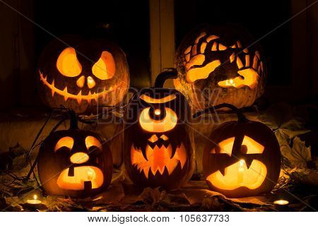 Photo Composition From Five Pumpkins For Halloween.