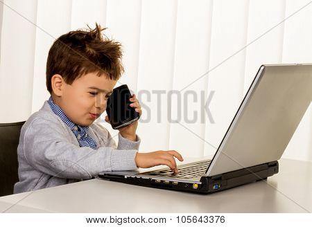 little boy on a laptop, symbol of internet, e-commerce, consumer behavior poster