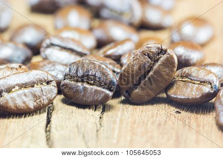 Coffee Beans texture on the wood background poster