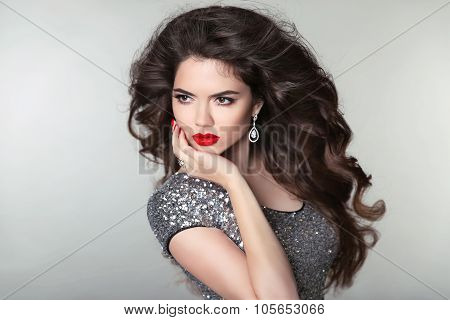 Hair. Beauty Makeup Beautiful Brunette Girl. Healthy Long Hair. Red Lips. Fashion Earrings Jewels. A