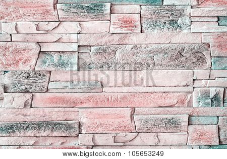 A fragment of the walls of the house are covered with ceramic tiles that mimic natural stone. poster