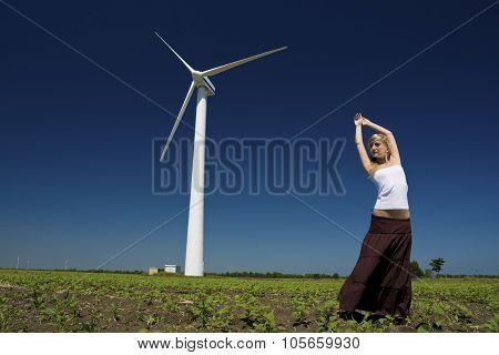 Female At Wind Power Generator