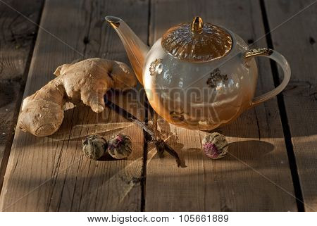 Stillife with kettle, ginger, vanilla and tea balls