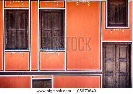 Orange Facade With Wooden Windows