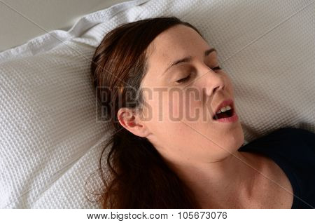 Young Woman Snoring In Bed