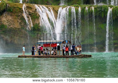 Tourist visit Ban Gioc waterfall by boat