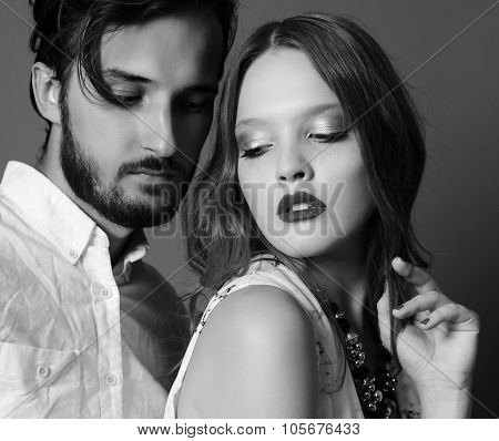 Fashion Studio Photo Of Sexy Young Coupl Of Brown-haired Woman And Brunette Man