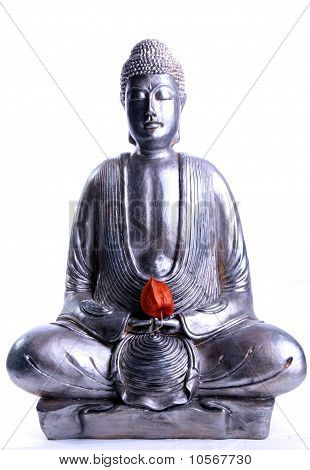 meditating Buddha with red flower