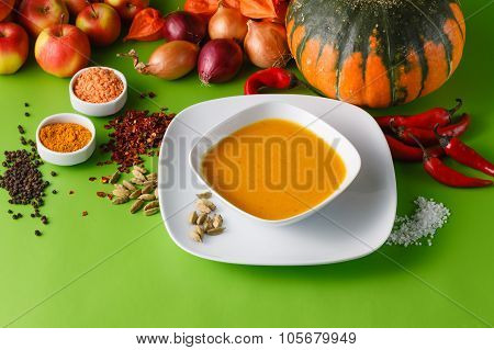 Pumpkin Soup With Onion And Pepper On Green Shadowless Backgroud