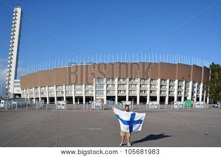 Man waving Finnish flag