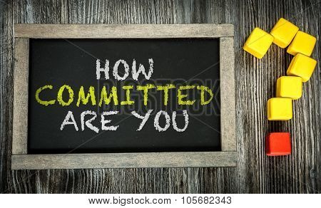 How Committed Are You? written on chalkboard poster