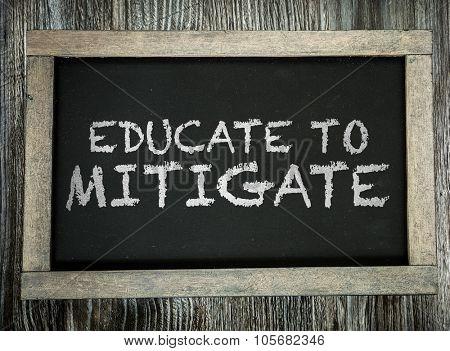 Educate to Mitigate written on chalkboard