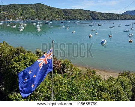 New Zealand Flag Proudly Fluttering In Marlborough Sounds