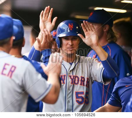 DENVER-AUG 21: New York Mets infielder Kelly Johnson in the dugout with teammates during a game against the Colorado Rockies at Coors Field on August 21, 2015 in Denver, Colorado.