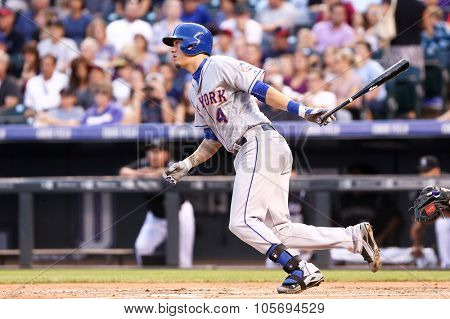 DENVER-AUG 21: New York Mets infielder Wilmer Flores swings a pitch during a game against the Colorado Rockies at Coors Field on August 21, 2015 in Denver, Colorado.