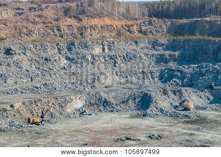 Sunny ambiance with resting digger in stone pit. Sverdlovsk region. Russia poster