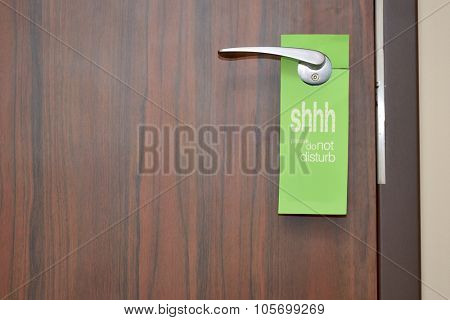 Door with do not disturb sign