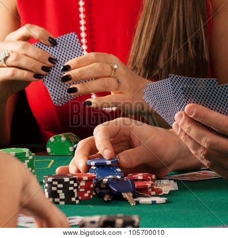 Gamblers Playing Poker Game