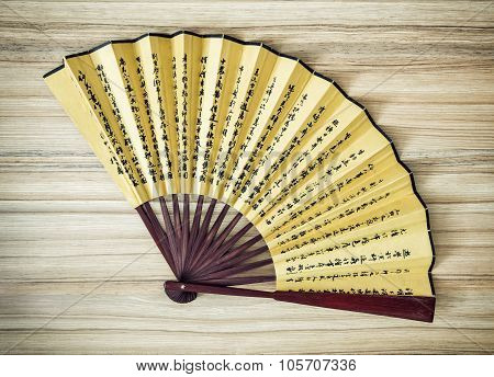 Traditional Eastern Fan On The Wooden Background