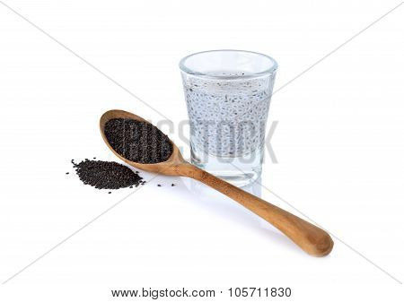 Hairy Basil Seeds In Small Glass And Wooden Spoon On White Background